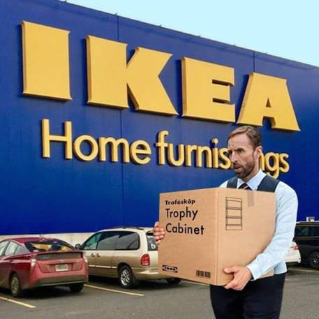 Garath Southgate carrying a trophy cabinet box outside IKEA